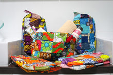 Eco friendly, spacious toiletry bag with beautiful African patchwork design.
