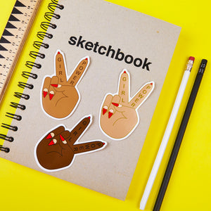 Girl Power Peace Sign Stickers in 3 skintones on a sketchbook by Zabby Allen