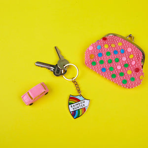 A Rainbow Hunter enamel keyring with keys, styled with a toy car and a playpurse. Original design by Zabby Allen