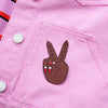 Girl Power Peace Sign Patch by Zabby Allen on Pink denim Jacket - Dark