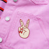 Girl Power Peace Sign Patch by Zabby Allen on Pink denim Jacket - Light