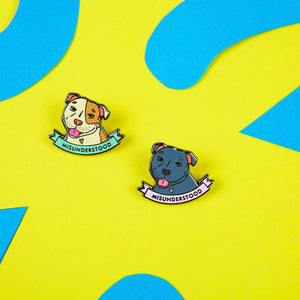 Enamel Pins featuring Staffordshire bull terries and a scroll reading Misunderstood