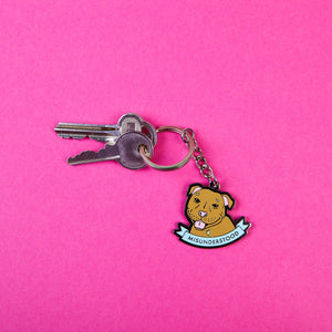 Keyring featuring a Staffordshire Bull Terrier Graphic Illustration and a scroll reading Misunderstood - design by Zabby Allen