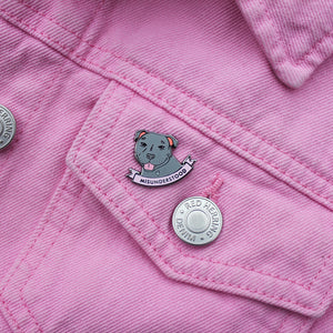 Enamel Pins featuring Staffordshire bull terries and a scroll reading Misunderstood - grey on pink denim jacket