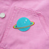 blue planet patch with rainbow rings on pink denim jacket