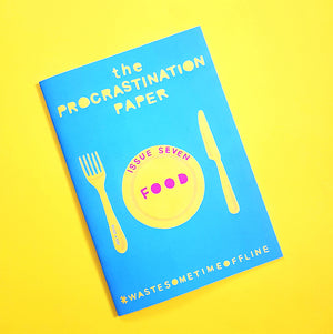 The Procrastination Paper - a mini magazine by Zabby Allen to encourage you to Waste Some Time Offline - the Food Issue - The cover has a papercut of a fork, knife and plate in yellow on a blue background and the title FOOD