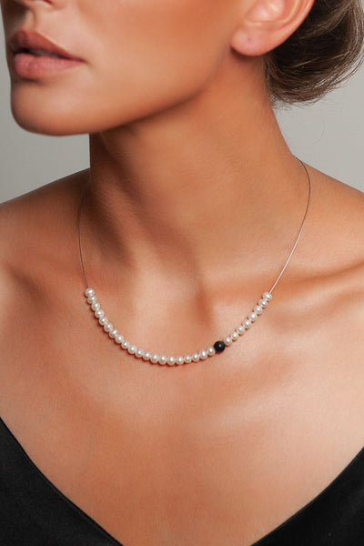 Abacus Pearl Necklace with an Onyx Bead by Peregrina Pearls on a Model