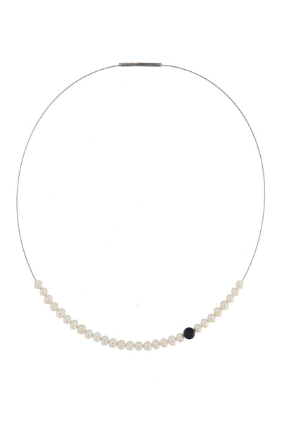 Abacus Pearl Necklace with an Onyx Bead by Peregrina Pearls - 28 small white freshwater pearls running on a steel cord, dramatized by one matte Onyx bead. A very nice black-and-white.