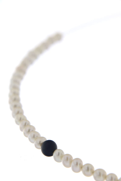 Abacus Pearl Necklace with an Onyx Bead by Peregrina Pearls - a close-up demonstrating pitch black onyx bead