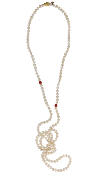Dearest Coco Pearl Necklace by Peregrina Pearls - a rope-style necklace featuring white freshwater pearls, accentuated by two genuine coral beads