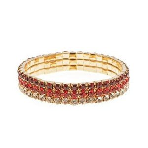 Reds set in gold Bun Ring