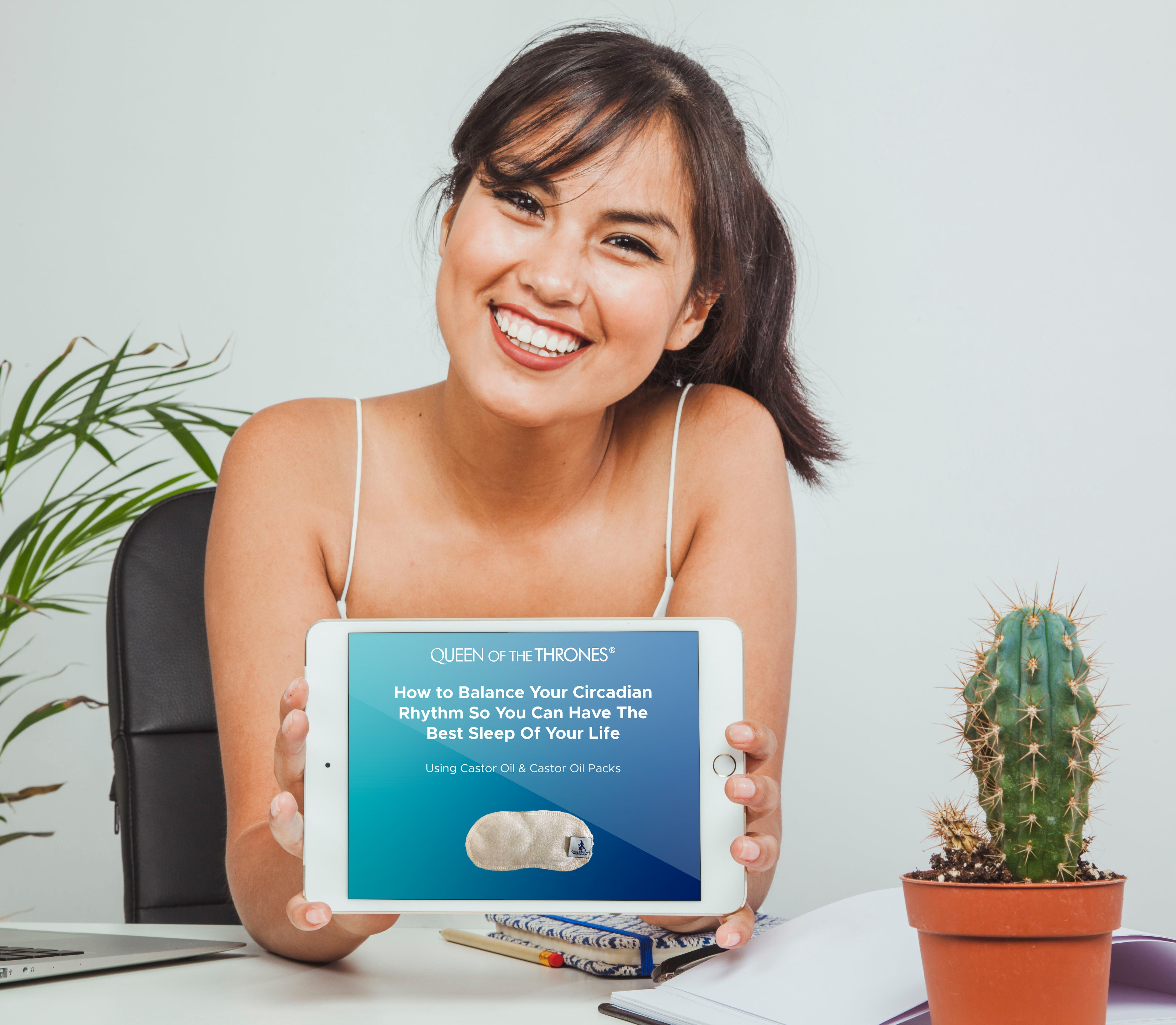 Smiling woman with Ipad displaying How to Balance Your Circadian Rhythm So You Can Have The Best Sleep Of Your Life