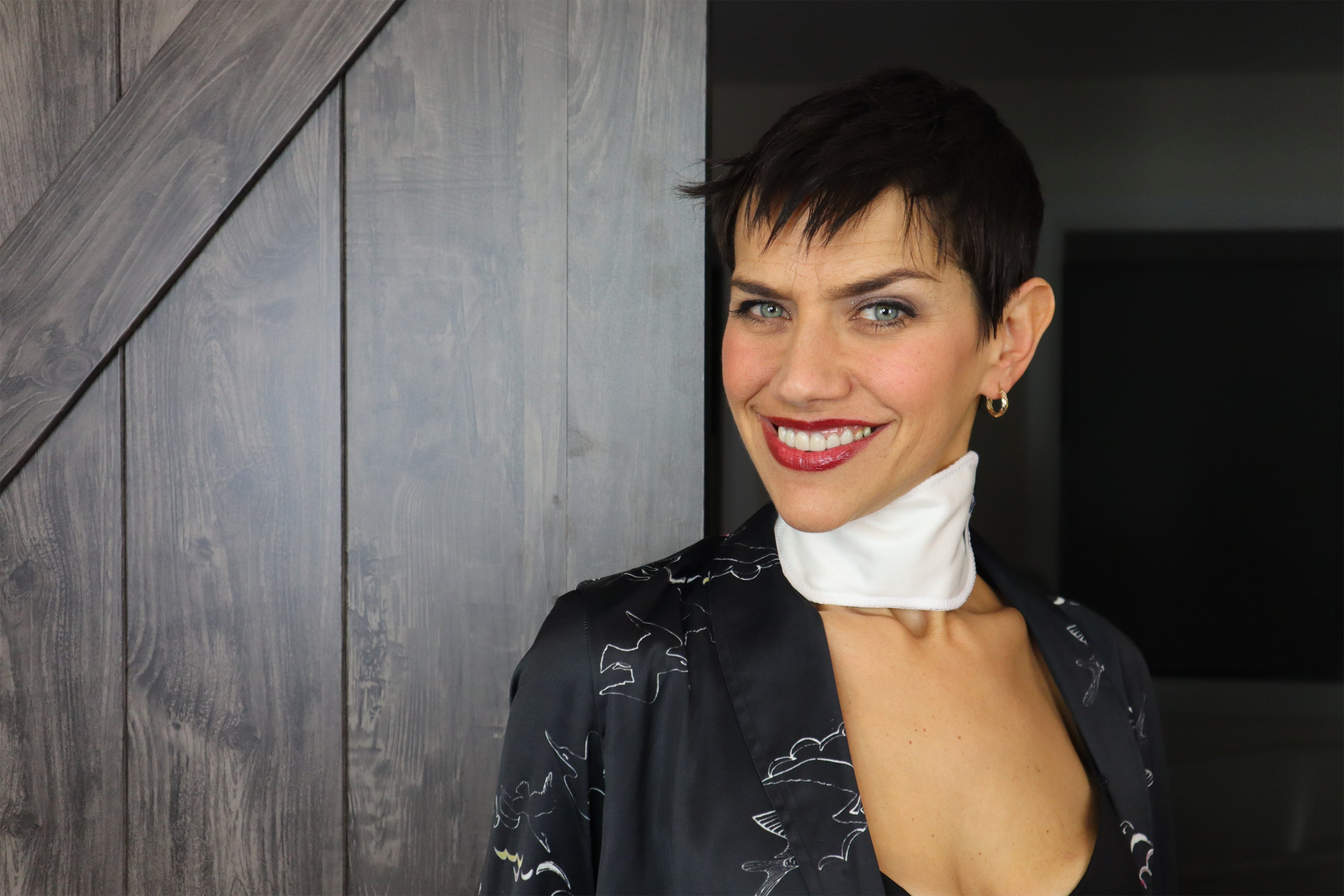 Dr Marisol smiling wearing the thyroid pack