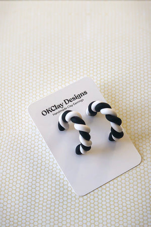 Open image in slideshow, The Twist Hoops by OKClay Designs