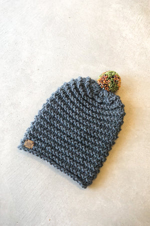 Open image in slideshow, The Mildred Pom Pom Beanie by Charcoal