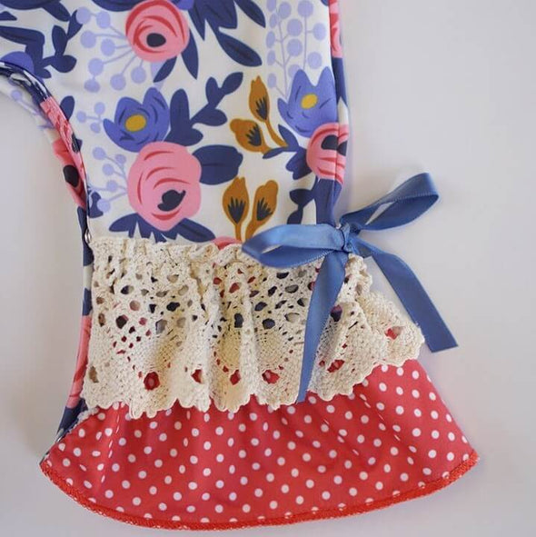 Ruffled Blue Floral Baby Romper Legs Close Up  Modist Threads Childrens Online Clothing Boutique and Monogramming