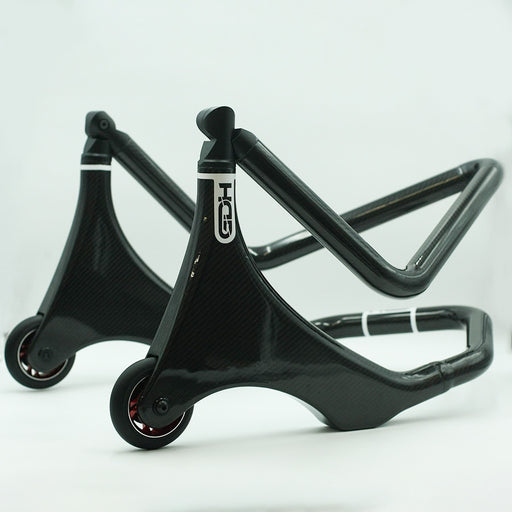 Carbon front under yoke paddock stand