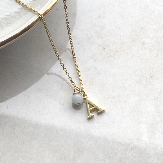 gold initial necklace with aquamarine birthstone