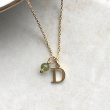 Load image into Gallery viewer, gold initial necklace with august birthstone