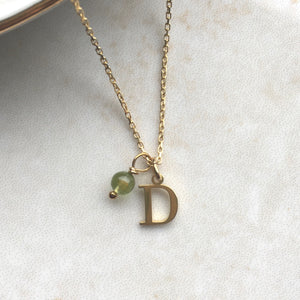 gold initial necklace with august birthstone