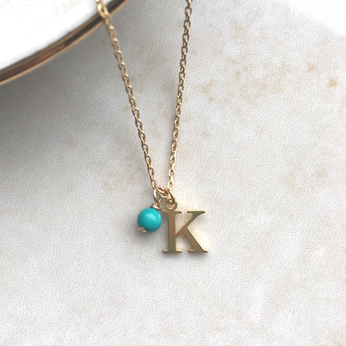 gold initial necklace with December birthstone