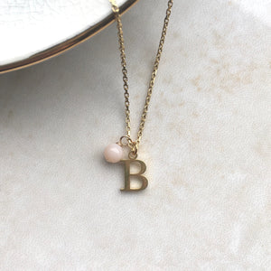 gold initial necklace with october birthstone