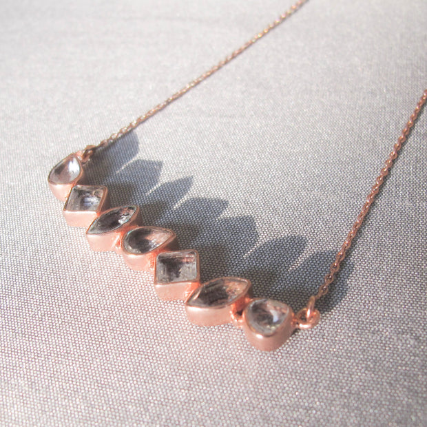 Our unique Rose Gold Bar Necklace features an array of mixed shaped stones creating this bold bar style necklace