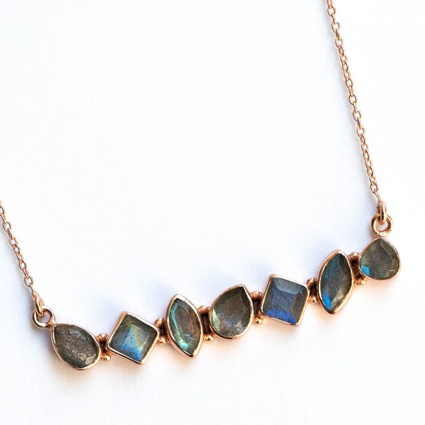 Simone Watson Jewellery - This unique necklace features an array of semi precious Labradorite stones, set in a bar style and handmade in sterling silver and 14 carat rose gold plating