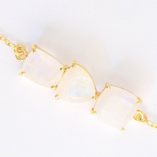 Three beautiful Moonstones create a unique balanced bar style bracelet, set on a dainty gold-plated adjustable chain