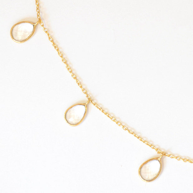 Three crystal stones are delicately attached to a fine gold plated chain to create this elegant and easy to wear bracelet