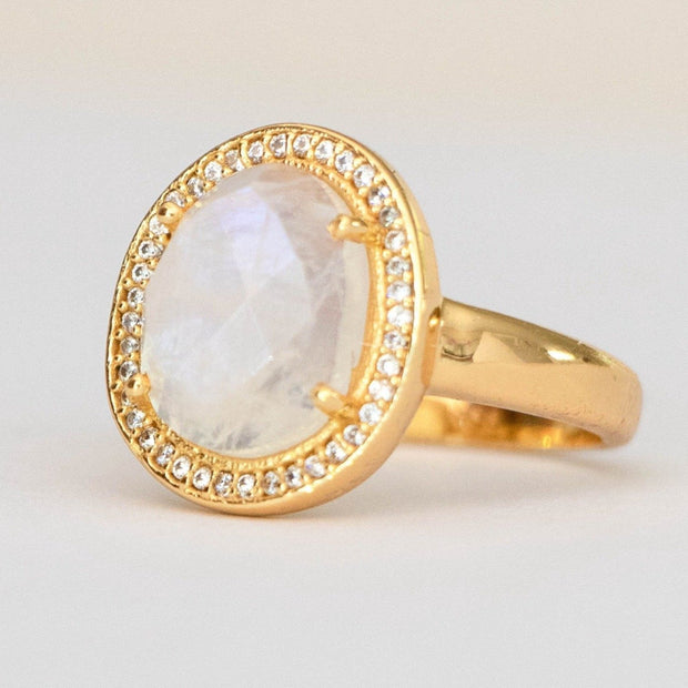 A beautiful solitaire Rainbow Moonstone stone that is surrounded by a halo of pave set cubic zirconias