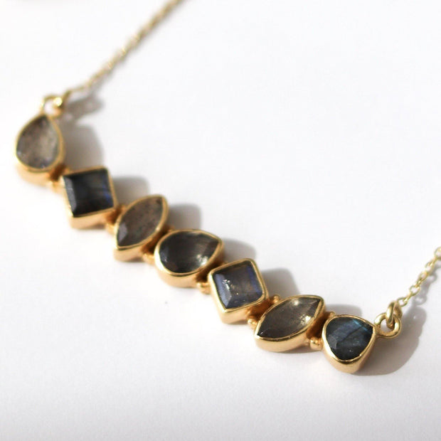 Our Bar Necklace features a row of Labradorite stones set in a balanced and bold bar style handmade in sterling silver and 14ct gold plating