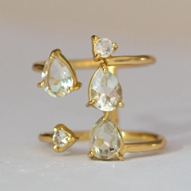 Stunning and unique, our Cascade ring features Green Amethyst semi precious stones set on a double band cuff style setting. Handmade in silver and 14 carat gold plating