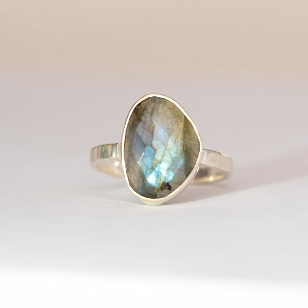 Simone Watson Jewellery This sterling silver solitaire ring features a beautiful organically shaped solitaire labradorite stone set on a single band