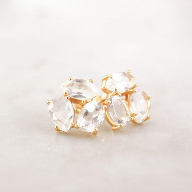A pair of Crystal Quartz cluster studs feature three uniquely shaped semi-precious gemstones. Wear these day or night to add a subtle touch of glamour to your look