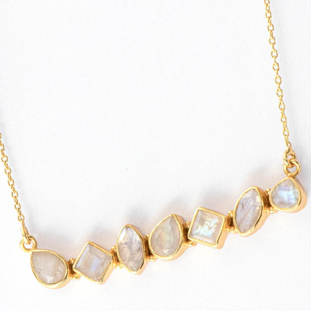 Our Moonstone Bar Necklace features an array of semiprecious stones creating a bold bar style necklace