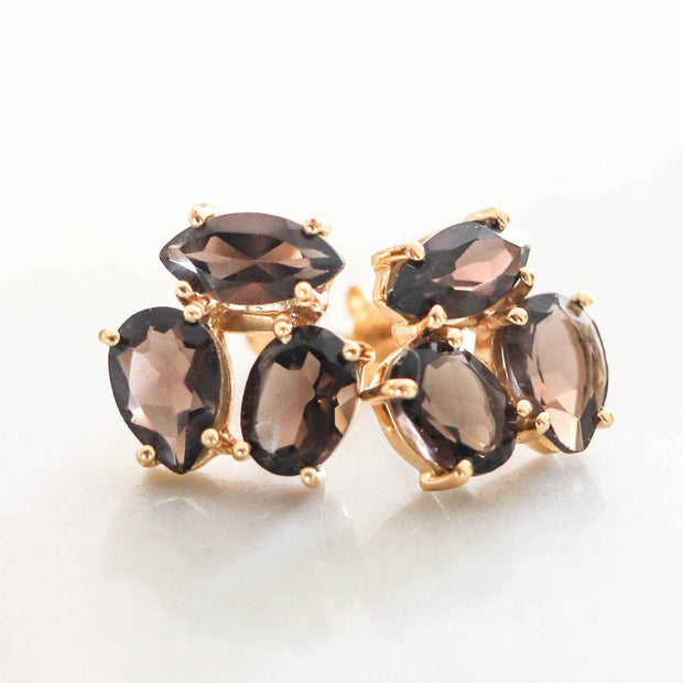 A pair of Smokey Quartz cluster studs feature three uniquely shaped semi-precious gemstones. Wear these day or night to add a subtle touch of glamour to your look