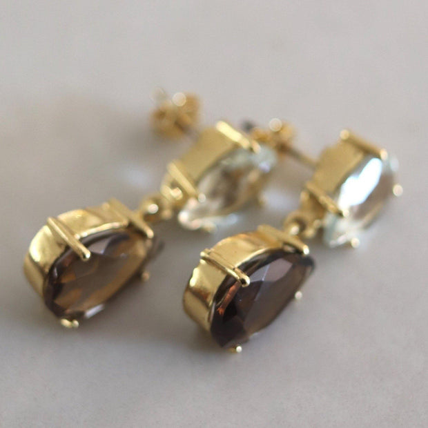 A pair of classic style drop earrings featuring pear shaped Smokey Quartz and Green Amethyst stones - perfect to be worn at the office or for a special occasion