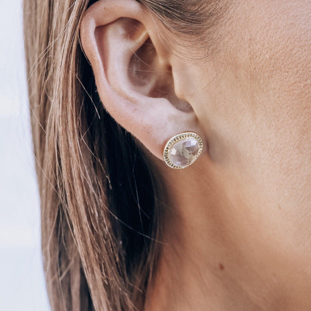 A pair of beautiful rose cut Crystal Quartz stones set in a pave halo and handmade in sterling silver and 14 carat yellow gold plating - adding a subtle finishing touch to your day or night look