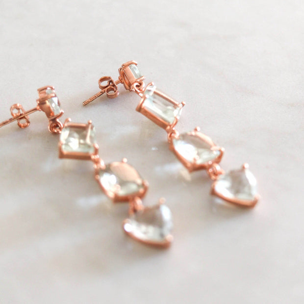 Beautiful and bold - these stunning cascade drop earrings are handmade in sterling silver and 14 carat rose gold plating and feature four uniquely cut green amethyst stones