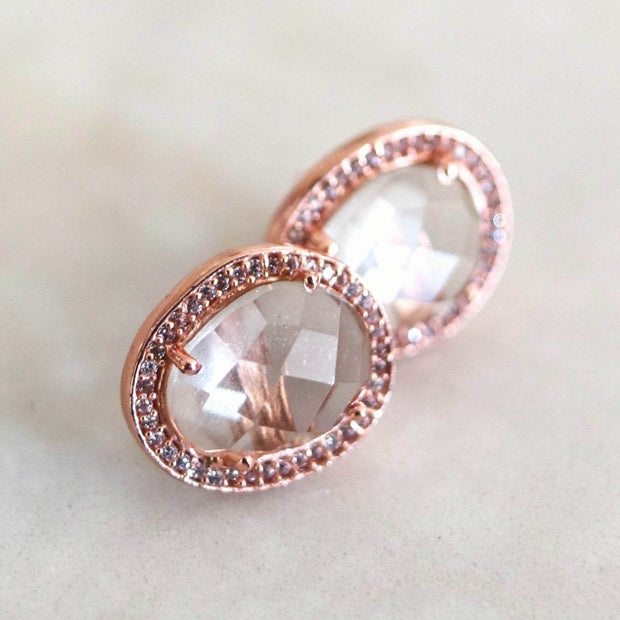 A pair of Green Amethyst rose cut stones set in a pave halo and handmade in sterling silver and 14 carat rose gold plating -adding a subtle finishing touch to your day or night look