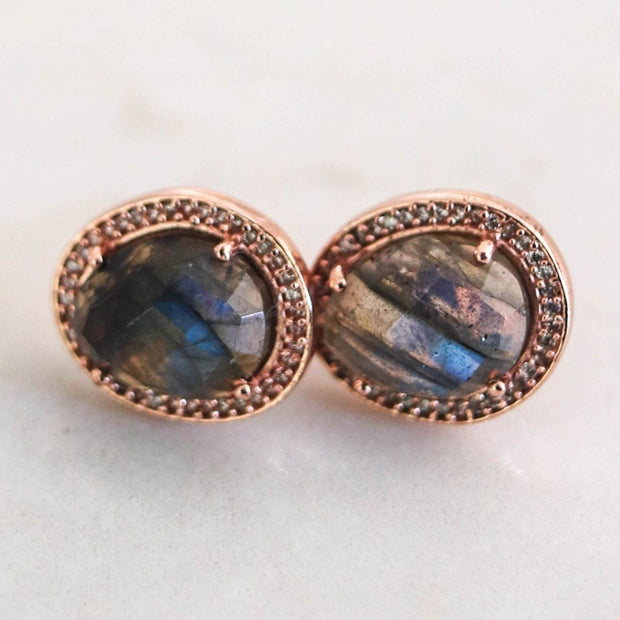 A pair of organically shaped Labradorite stones are surrounded by a halo of pave set cubic zirconias -adding a subtle touch of shimmer to your day or night look