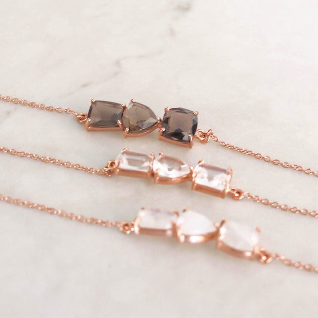Three Crystal Quartz stones create a bar style bracelet set on a fine dainty rose gold plated adjustable chain