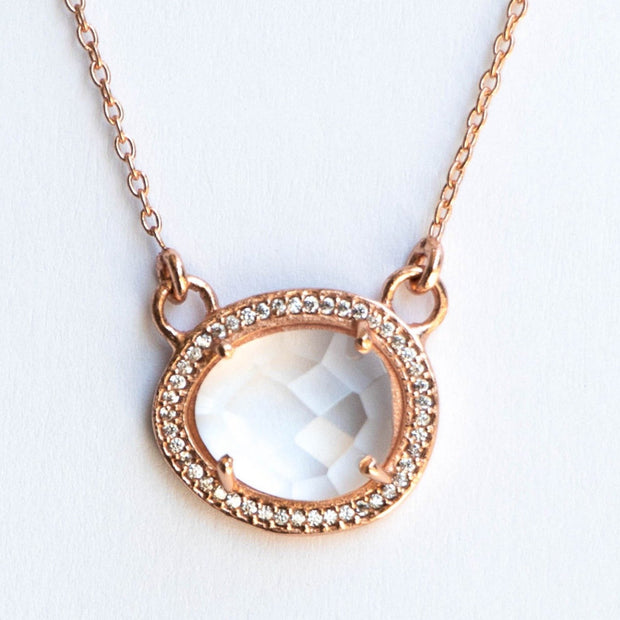 This beautiful pendant features a rose cut Crystal Quartz stone surrounded by a halo of pave set cubic zirconias. Set on a dainty adjustable 14 carat rose gold plated chain