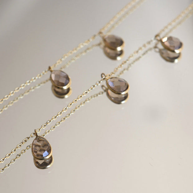 Three smokey quartz stones are delicately attached to a fine gold plated chain to create this elegant and easy to wear bracelet