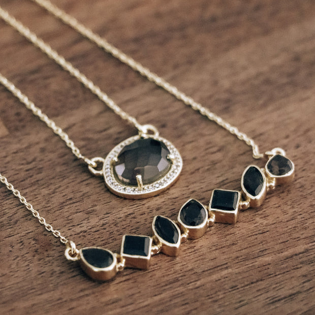 This beautiful pendant features a naturally shaped Smokey Quartz semi-precious gemstone surrounded by a halo of pave set cubic zirconias set on a dainty adjustable chain