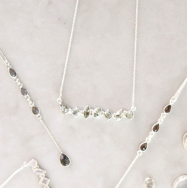 This unique necklace features an array of semi precious Green Amethyst stones, set in a bar style and handmade in sterling silver