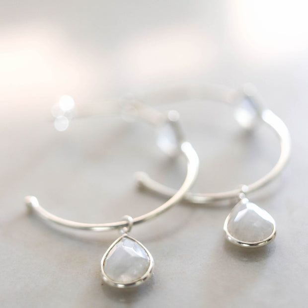 These charming hoop earrings are handmade in sterling silver and feature gorgeous rainbow moonstone semi-precious gemstones