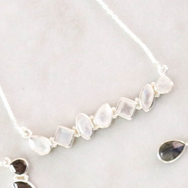 This unique piece features an array of semi precious moonstones set in a bar style necklace and handmade in sterling silver