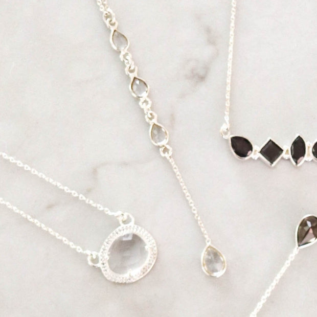 Dainty and elegant lariat necklaces featuring four pear shaped semi precious stones. Available in stone options: Smokey Quartz, Moonstone, Crystal Quartz, Labradorite & Green Amethyst